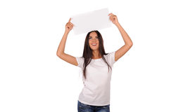 Beautiful girl holding a blank billboard Stock Photography