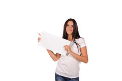 Beautiful girl holding a blank billboard Royalty Free Stock Photography