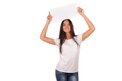 Beautiful girl holding a blank billboard Royalty Free Stock Photos