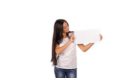 Beautiful girl holding a blank billboard Stock Image
