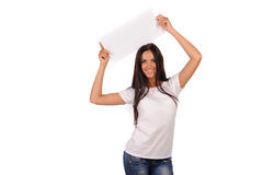 Beautiful girl holding a blank billboard Royalty Free Stock Photo