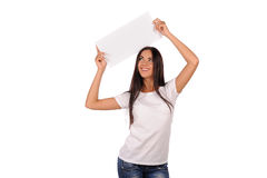 Beautiful girl holding a blank billboard Royalty Free Stock Photos