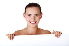Beautiful girl  holding blank board. Stock Photos