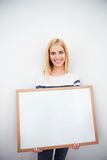 Beautiful girl holding blank board Stock Photography