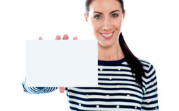 Beautiful girl holding blank card. Copyspace Royalty Free Stock Photography