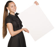 Beautiful girl holding blank white placard and Royalty Free Stock Photography