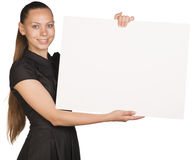 Beautiful girl holding blank white placard and Stock Photo