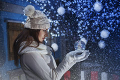 Beautiful girl holding a Boule-de-neige Royalty Free Stock Photography