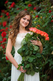 Beautiful girl holding bouquet of pink roses flowers Royalty Free Stock Photos