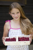 Beautiful girl holding a box with a raspberry Royalty Free Stock Photography