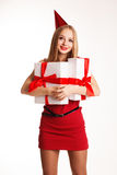 Beautiful girl holding boxes with birthday gifts Royalty Free Stock Photography