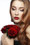 Beautiful girl holding bunch of roses Royalty Free Stock Photos