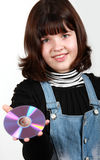 Beautiful girl holding a CD Stock Images