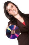 Beautiful girl holding a cd rom Royalty Free Stock Images