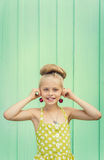 Beautiful girl holding cherries as earrings -style Rockabilly. Stock Photography
