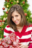 Beautiful girl holding Christmas gift Royalty Free Stock Images