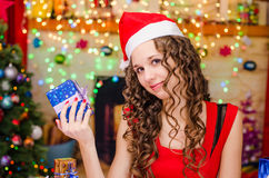 Beautiful girl holding a Christmas gift Royalty Free Stock Images