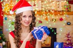 Beautiful girl holding Christmas gift Stock Photo