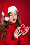 Beautiful girl holding Christmas present Stock Photography