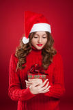 Beautiful girl holding Christmas present Royalty Free Stock Image