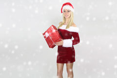 Beautiful girl holding a Christmas present Royalty Free Stock Photo