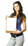 Beautiful girl holding clipboard with blank paper Royalty Free Stock Images