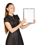 Beautiful girl holding a clipboard in hand and Royalty Free Stock Images
