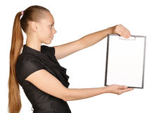 Beautiful girl holding a clipboard in hand and Stock Photos