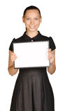 Beautiful girl holding a clipboard in hand and Royalty Free Stock Photography