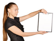 Beautiful girl holding a clipboard in hand and Royalty Free Stock Photos