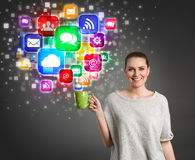 Beautiful girl holding coffee cup with colorful media icons Royalty Free Stock Photos