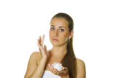 Beautiful girl holding cream Royalty Free Stock Images