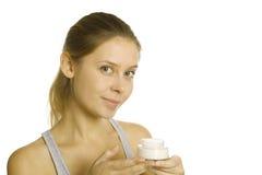 Beautiful girl holding cream Stock Photography
