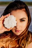 Girl holding a salt crystal royalty free stock images