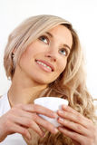 Beautiful girl holding a cup Stock Photography