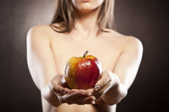 Beautiful girl holding a delicious apple Royalty Free Stock Photography