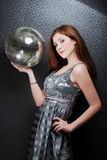 Beautiful girl holding disco ball. Studio shot stock images