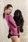 Beautiful girl holding a dog Stock Photo