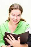 Beautiful girl holding ebook in hands Royalty Free Stock Image
