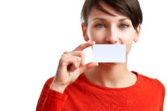 Beautiful girl holding an empty business card. Hiding her mouth stock photography