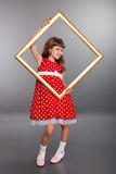 Beautiful girl holding an empty frame Stock Photography