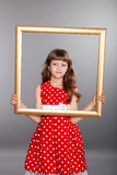 Beautiful girl holding an empty frame Stock Photo