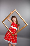 Beautiful girl holding an empty frame Stock Images