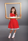 Beautiful girl holding an empty frame Royalty Free Stock Images