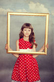 Beautiful girl holding an empty frame Royalty Free Stock Photography