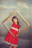Beautiful girl holding an empty frame Royalty Free Stock Photo