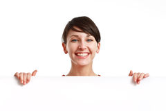 Beautiful girl holding an empty white board Royalty Free Stock Image