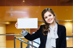 Beautiful girl holding empty white card and smiling Stock Image