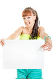 Beautiful girl holding empty white paper for commercial advertis Stock Photo