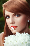Beautiful girl holding a flower in her mouth Royalty Free Stock Photo